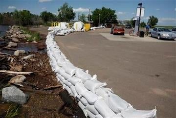 People fill up with gas at a bait shop ringed by sandbags on Lake Oahe near Mobridge, S.D., Tuesday, May 7, 2011. (AP Photo/The Argus Leader, Devin Wagner) THE DAILY REPUBLIC OUT By Devin Wagner