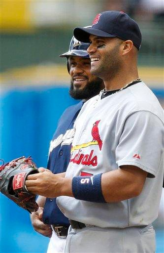 Milwaukee Brewers' Prince Fielder, left, and St. Louis Cardinals' Albert Pujols smile during the third inning of a baseball game Sunday, June 12, 2011, in Milwaukee.  (AP Photo/Jeffrey Phelps) By Jeffrey Phelps
