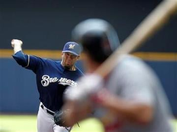 Milwaukee Brewers starting pitcher Shaun Marcum throws to a St. Louis Cardinals batter in the first inning of a baseball game Sunday, June 12, 2011, in Milwaukee. (AP Photo/Jeffrey Phelps) By Jeffrey Phelps