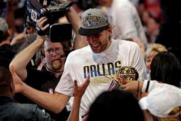 Dallas Mavericks' Dirk Nowitzki celebrates after Game 6 of the NBA Finals basketball game against the Miami Heat Sunday, June 12, 2011, in Miami. The Mavericks won 105-95 to win the series. (AP Photo/David J. Phillip) By David J. Phillip