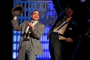 """Norbert Leo Butz, left, performs with the cast of """"Catch Me If You Can"""" during the 65th annual Tony Awards in New York, Sunday, June 12, 2011. (AP Photo/Henny Ray Abrams) By Jeff Christensen"""