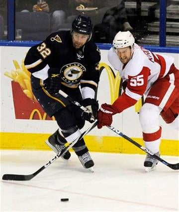 St. Louis Blues' Chris Porter (32) and Detroit Red Wings' Niklas Kronwall (55), of Sweden, go for the loose puck in the second period of an NHL hockey game, Saturday, March 12, 2011, in St. Louis. (AP Photo/Bill Boyce) By Bill Boyce