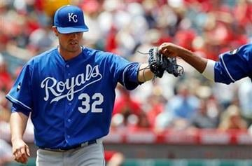 Kansas City Royals starting pitcher Vin Mazzaro celebrates as he leave the field against the Los Angeles Angels during the seventh inning of a baseball game in Anaheim, Calif., Sunday, June 12, 2011. (AP Photo/Chris Carlson) By Chris Carlson