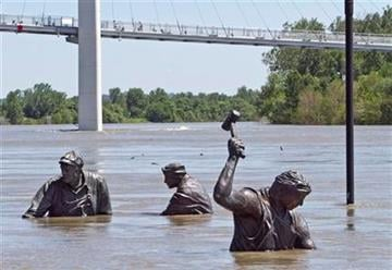 Statues of workers of various trades, part of the Monument for Labor by Matthew J. Placzek, stand in the rising waters of the Missouri River, in Omaha, Neb., Wednesday, June 15, 2011. (AP Photo/Nati Harnik) By Nati Harnik