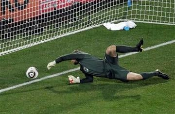 England's Robert Green fails to save a goal during the World Cup group C soccer match between England and the United States at Royal Bafokeng Stadium in Rustenburg, South Africa, on Saturday, June 12, 2010.  (AP Photo/Michael Sohn) By Michael Sohn