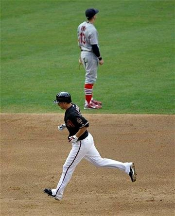 Arizona Diamondbacks' Adam LaRoche, bottom, rounds the bases after hitting a solo home run as St. Louis Cardinals' Brendan Ryan looks away during the third inning of a baseball game Saturday, June 12, 2010, in Phoenix. (AP Photo/Matt York) By Matt York