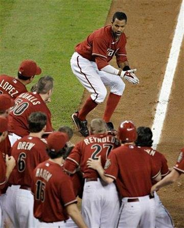 Arizona Diamondbacks' Chris Young is greeted by teammates at home plate after a two-run home run to give the Diamondbacks a 7-5 win over the St. Louis Cardinals in a baseball game Sunday, June 13, 2010, in Phoenix. (AP Photo/Matt York) By Matt York
