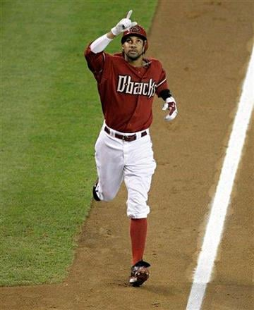 Arizona Diamondbacks' Chris Young celebrates his solo home run against the St. Louis Cardinals during the fourth inning of a baseball game Sunday, June 13, 2010, in Phoenix. (AP Photo/Matt York) By Matt York