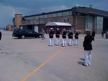 Marine Honor Guard waits for arrival By KMOV Web Producer