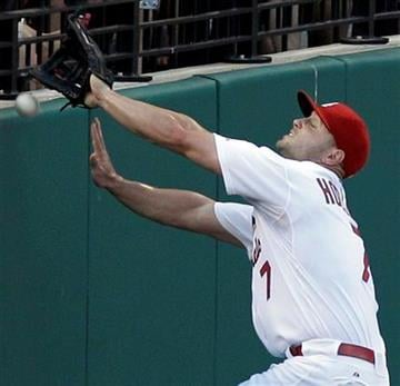 St. Louis Cardinals left fielder Matt Holliday cannot come up with a ball hit in foul territory by Oakland Athletics' Kurt Suzuki during the second inning of a baseball game Friday, June 18, 2010, in St. Louis. (AP Photo/Jeff Roberson) By Jeff Roberson