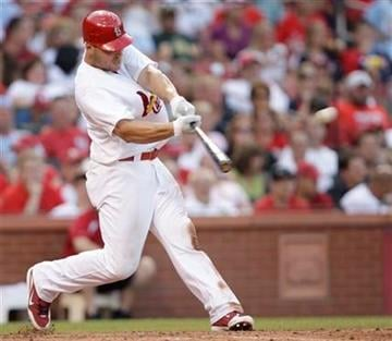 St. Louis Cardinals' Matt Holliday (7) connects for an RBI double in the fifth inning of an interleague baseball game against the Oakland Athletics, Saturday, June 19, 2010 in St. Louis.(AP Photo/Tom Gannam) By Tom Gannam
