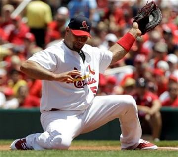 St. Louis Cardinals first baseman Albert Pujols stops a grounder down the line by Oakland Athletics' Landon Powell for an out during the second inning of a baseball game Sunday, June 20, 2010, in St. Louis. (AP Photo/Jeff Roberson) By Jeff Roberson
