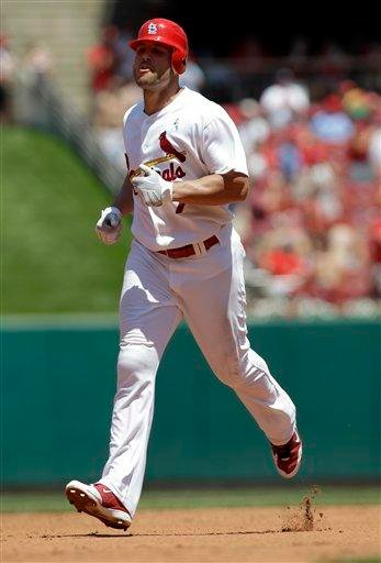 St. Louis Cardinals' Matt Holliday rounds the bases on a solo home run during the fourth inning of a baseball game against the Oakland Athletics on Sunday, June 20, 2010, in St. Louis. (AP Photo/Jeff Roberson) By Jeff Roberson