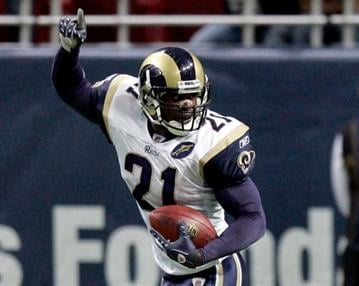 October 19, 2008 - St. Louis Rams' Oshiomogho Atogwe celebrates after intercepting a pass intended for Dallas Cowboys wide receiver Terrell Owens during an NFL football game in St. Louis. (Jeff Roberson/AP) By Jeff Roberson