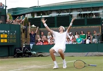 John Isner of the US reacts as he defeats France's Nicolas Mahut, in their epic men's singles match at the All England Lawn Tennis Championships at Wimbledon, Thursday, June 24, 2010. (AP Photo/Suzanne Plunkett, pool) By Suzanne Plunkett