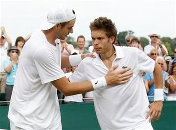 John Isner of the US, left,  consoles France's Nicolas Mahut,at the end of their epic men's singles match at the All England Lawn Tennis Championships at Wimbledon, Thursday, June 24, 2010. (AP Photo/Suzanne Plunkett, pool) By Suzanne Plunkett