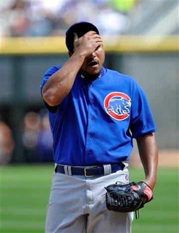 Chicago Cubs' Carlos Zambrano reacts to giving up a run against the Chicago White Sox during the first inning of a baseball game Friday, June 25, 2010, in Chicago. (AP Photo/Jim Prisching) By Jim Prisching