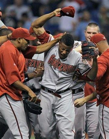 Arizona Diamondbacks pitcher Edwin Jackson, center, celebrates after throwing a no-hitter against the Tampa Bay Rays during a baseball game Friday, June 25, 2010, in St. Petersburg, Fla. (AP Photo/Chris O'Meara) By Chris O'Meara