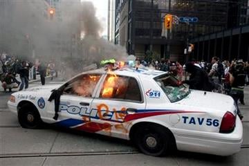 A police car burns after anti G20 summit protesters set fire to it in downtown Toronto on Saturday, June 26, 2010.  (AP Photo/The Canadian Press, Chris Young) By Chris Young
