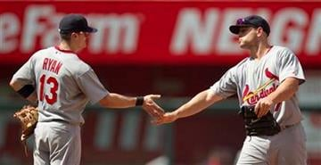 St. Louis Cardinals' Brendan Ryan (13) and Matt Holliday celebrate after their 5-3 win over the Kansas City Royals in a baseball game Saturday, June 26, 2010 in Kansas City, Mo.  (AP Photo/Charlie Riedel) By Charlie Riedel