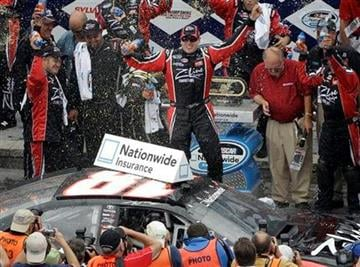 Driver Kyle Busch celebrates after winning the NASCAR Nationwide Series New England 200 auto race at New Hampshire Motor Speedway in Loudon, N.H., Saturday June 26, 2010.(AP Photo/Charles Krupa) By Charles Krupa