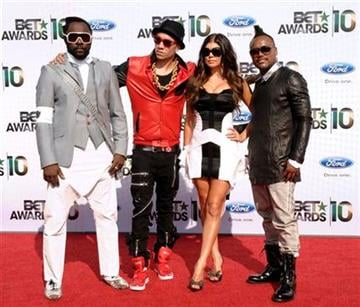 From left, will.i.am, Taboo, Fergie and apl.de.ap of The Black Eyed Peas arrive at the BET Awards on Sunday, June 27, 2010 in Los Angeles. (AP Photo/Dan Steinberg) By Dan Steinberg