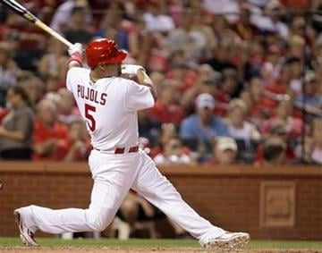 St. Louis Cardinals' Albert Pujols (5) follows through after hitting an rbi double in the sixth inning of a baseball game against the Arizona Diamondbacks, Tuesday, June 29, 2010 in St. Louis.(AP Photo/Tom Gannam) By Tom Gannam