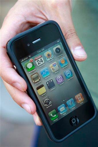 Daniel Rudofsky, 21, holds his new iPhone after standing in line outside the Apple Store in the Georgetown neighborhood of Washington, on Thursday, June 24, 2010. (AP Photo/Jacquelyn Martin) By Jacquelyn Martin