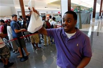 Aaron West of Maple Shade, N.J., was the first customer in line to buy new Apple iPhone 4, at the Apple Store in the Cherry Hill Mall Thursday, June 24, 2010, in Cherry Hill, N.J. (AP Photo/Mel Evans) By Mel Evans