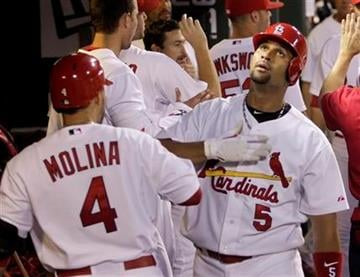 St. Louis Cardinals' Albert Pujols (5) celebrates with teammate Yadier Molina (4) after hitting a two-run home run in the fifth inning of a baseball game, Tuesday, June 29, 2010 in St. Louis.(AP Photo/Tom Gannam) By Tom Gannam