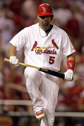 St. Louis Cardinals' Albert Pujols shows his frustration after lining out to end the eighth inning of a baseball game against the Milwaukee Brewers Thursday, July 1, 2010, in St. Louis. (AP Photo/Jeff Roberson) By Jeff Roberson