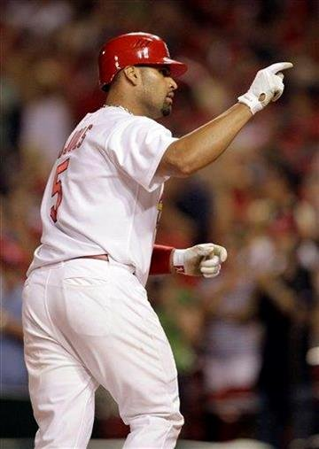 St. Louis Cardinals' Albert Pujols points into the stands as he rounds the bases on a solo home run during the seventh inning of a baseball game against the Milwaukee Brewers Thursday, July 1, 2010, in St. Louis. (AP Photo/Jeff Roberson) By Jeff Roberson