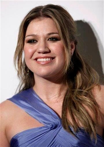 FILE - In this Feb. 7, 2009 file photo, Kelly Clarkson arrives at the Clive Davis pre-Grammy party in Beverly Hills, Calif. (AP Photo/Matt Sayles, file) By Matt Sayles