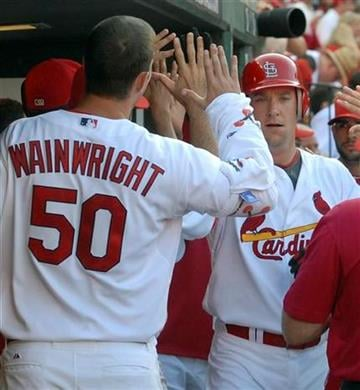 St. Louis Cardinals' Ryan Ludwick, right, is congratulated by Adam Wainwright after his three-run home run against the  Seattle Mariners in a baseball game Monday, June 14, 2010, in St. Louis. The Cardinals won 9-3. (AP Photo/Bill Boyce) By Bill Boyce