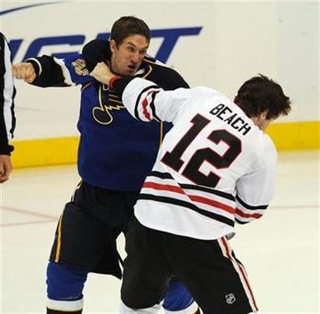 St. Louis Blues' B.J. Crombeen, left, and Chicago Blackhawks' Kyle Beach (12) fight in the first period of an NHL preseason hockey game Thursday, Sept. 30, 2010 ,in St. Louis. (AP Photo/Bill Boyce) By Bill Boyce