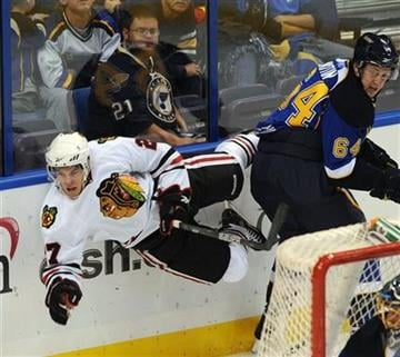 Chicago Blackhawks' Jeremy Morin, left, collides with St. Louis Blues' Nikita Nikitin (64) in the second period of an NHL preseason hockey game Thursday, Sept. 30, 2010, in St. Louis. (AP Photo/Bill Boyce) By Bill Boyce