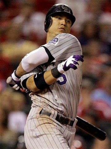 Colorado Rockies' Carlos Gonzalez is twisted up as he swings an misses during the eighth inning of a baseball game against the St. Louis Cardinals Friday, Oct. 1, 2010, in St. Louis. (AP Photo/Jeff Roberson) By Jeff Roberson