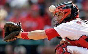 A foul ball off the bat of Colorado Rockies' Todd Helton bounces off the helmet of St. Louis Cardinals catcher Matt Pagnozzi during the fourth inning of a baseball game Saturday, Oct. 2, 2010, in St. Louis. (AP Photo/Jeff Roberson) By Jeff Roberson