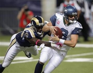 St. Louis Rams defensive end George Selvie (90) sacks Seattle Seahawks quarterback Matt Hasselbeck (8) during the second quarter of an NFL football game Sunday, Oct. 3, 2010, in St. Louis. (AP Photo/Tom Gannam) By Tom Gannam