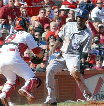 Colorado Rockies' Dexter Fowler (24) is tagged out at home by St. Louis Cardinals' Matt Pagnozzi during the fourth inning in a baseball game Sunday, Oct. 3, 2010, in St. Louis. (AP Photo/Bill Boyce) By Bill Boyce
