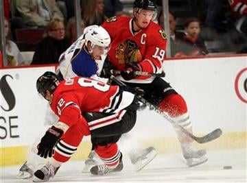 St. Louis Blues' David Spina gets squeezed between Chicago Blackhawks' Tomas Kopecky, left, and Jonathan Toews during the first period of a preseason NHL hockey game Sunday, Oct. 3, 2010, in Chicago. (AP Photo/Charles Cherney) By Charles Cherney