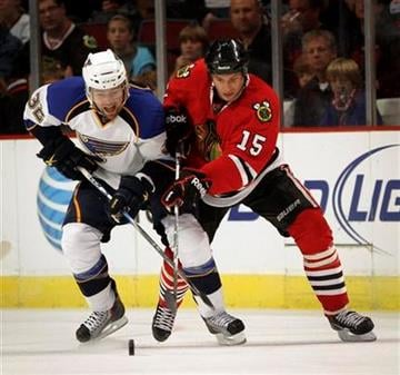 St. Louis Blues' Chris Porter and Chicago Blackhawks' Fernando Pisani vie for puck during the third period of a preseason NHL hockey game Sunday, Oct. 3, 2010, in Chicago. (AP Photo/Charles Cherney) By Charles Cherney