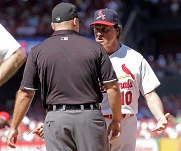St. Louis Cardinals manager Tony La Russa argues with first base umpire Mike Carlson after a close play at first in the sixth inning of a baseball game against the Cincinnati Reds, Sunday, Sept. 5, 2010 in St. Louis.(AP Photo/Tom Gannam) By Tom Gannam