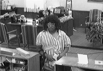 The suspect in these surveillance photos is accused of holding up the Southern Commercial Bank at 3207 Meramec in September. By Lakisha Jackson