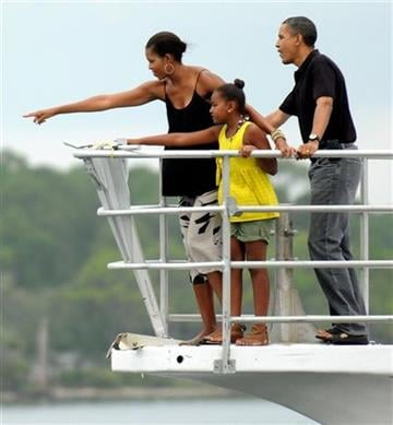 President Barack Obama, first lady Michelle and daughter Sasha, 9, spot a porpoise on Sunday, Aug. 15, 2010 in St. Andrew Bay near Panama City, Fla. (AP Photo/Andrew Wardlow, Pool) By Andrew Wardlow