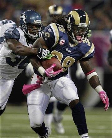 St. Louis Rams running back Steven Jackson (39) runs from Seattle Seahawks safety Lawyer Milloy (36) during the first quarter of an NFL football game Sunday, Oct. 3, 2010, in St. Louis. (AP Photo/Jeff Roberson) By Jeff Roberson