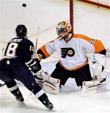 Philadelphia Flyers goalie Brian Boucher, right, deflects a shot from St. Louis Blues' Jay McClement during the first period of an NHL hockey game Saturday, Oct. 9, 2010, in St. Louis. (AP Photo/Jeff Roberson) By Jeff Roberson