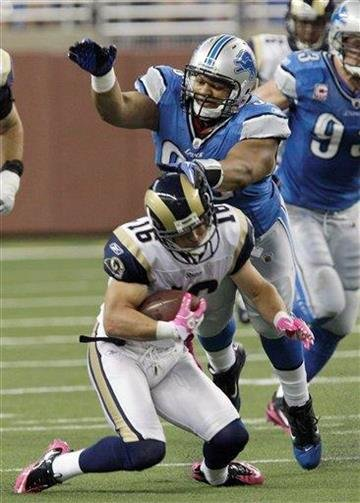 Detroit Lions defensive tackle Ndamukong Suh (90) tackles St. Louis Rams wide receiver Danny Amendola (16) during the first quarter of an NFL football game in Detroit, Sunday, Oct. 10, 2010. (AP Photo/Carlos Osorio) By Carlos Osorio