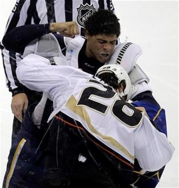 St. Louis Blues' Ryan Reaves, top, and Anaheim Ducks' Kyle Chipchura fight during the second period of an NHL hockey game Monday, Oct. 11, 2010, in St. Louis. (AP Photo/Jeff Roberson) By Jeff Roberson