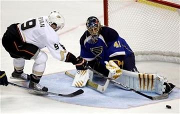 St. Louis Blues goalie Jaroslav Halak, of Slovakia, makes a save on a shot by Anaheim Ducks' Bobby Ryan, left, during the second period of an NHL hockey game Monday, Oct. 11, 2010, in St. Louis. (AP Photo/Jeff Roberson) By Jeff Roberson